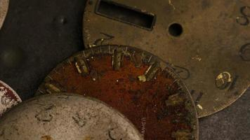 Rotating stock footage shot of antique and weathered watch faces - WATCH FACES 009