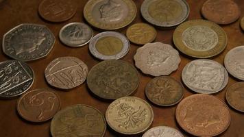 rotação de imagens de estoque de moedas monetárias internacionais - dinheiro 0386