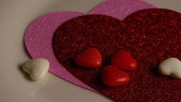 Rotating stock footage shot of Valentines decorations and candies - VALENTINES 0099 video