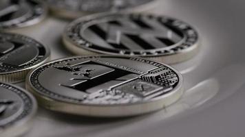 colpo rotante di bitcoin litecoin (criptovaluta digitale) - bitcoin litecoin 0141