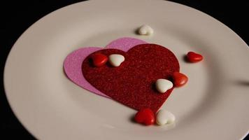Rotating stock footage shot of Valentines decorations and candies - VALENTINES 0101 video