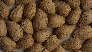 Cinematic, rotating shot of almonds on a white surface - ALMONDS 049