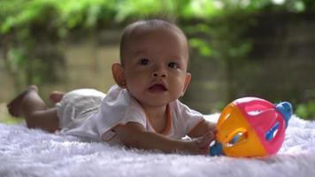 Happy portrait baby boy playing alone