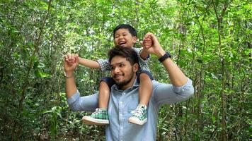 Dad and son have a happy time in nature.