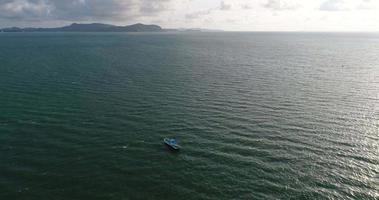 Top view of a blue boat sailing in the sea