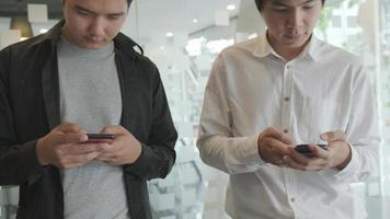 Young men using mobile phone video