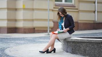 Woman Reading A Book In The City