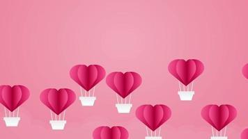 globos de corazón flotando sobre un fondo rosa