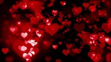muchos corazones rojos se desvanecen en bokeh video
