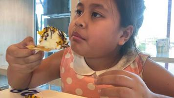 Little girl eating Indian food  video