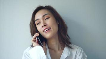 Happy Young Asian Woman with mobile phone