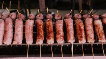 Charcoal grilled Sai krok Isaan sausage skewers video