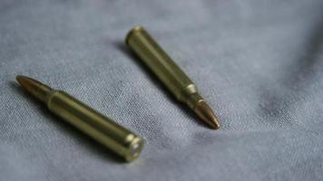 Cinematic rotating shot of bullets on a fabric surface - BULLETS 103