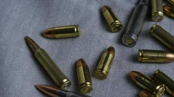 Cinematic rotating shot of bullets on a fabric surface - BULLETS 093