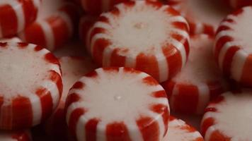 Rotating shot of peppermint candies - CANDY PEPPERMINT 064 video
