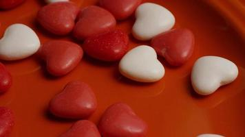 Rotating stock footage shot of Valentines decorations and candies - VALENTINES 0054 video