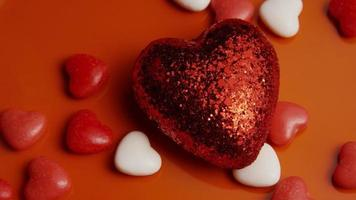 Rotating stock footage shot of Valentines decorations and candies - VALENTINES 0047 video