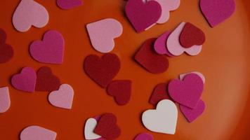 Rotating stock footage shot of Valentines decorations and candies - VALENTINES 0092 video