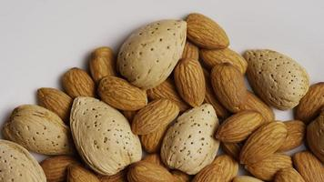 Cinematic, rotating shot of almonds on a white surface - ALMONDS 169