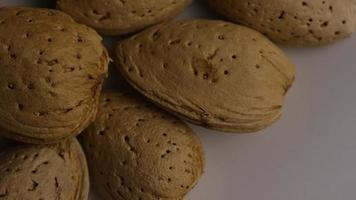 Cinematic, rotating shot of almonds on a white surface - ALMONDS 058