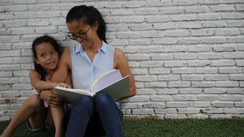 Mother and daughter read funny stories. video