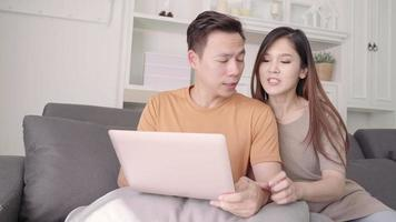 Asian couple using laptop for searching the web