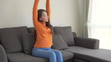 Young Asian Woman Relaxing On The Couch video