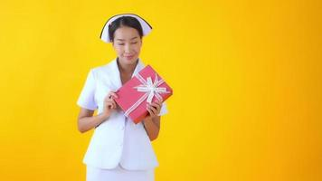 Thai nurse with gift box