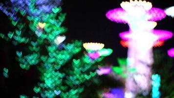Jardim colorido bokeh luz em forma de coração video
