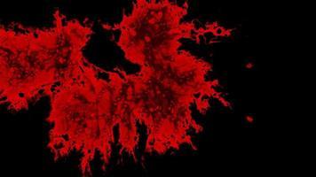 inchiostro rosso sanguinante scende e si diffonde su sfondo nero