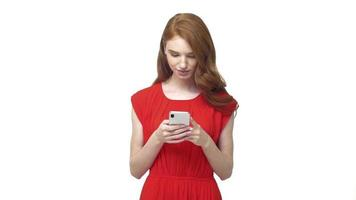 Young positive woman texting on a smartphone and smiling