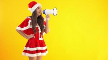 Asian wears Christmas costume and uses megaphone