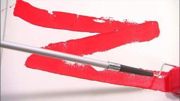 rodillo de pintura roja