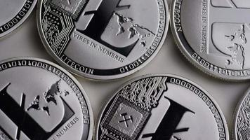 Rotating shot of Litecoin Bitcoins (digital cryptocurrency) - BITCOIN LITECOIN 0110 video