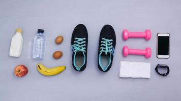 Stop motion - objects for exercise on gray background.
