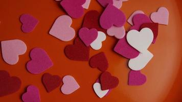 Rotating stock footage shot of Valentines decorations and candies - VALENTINES 0093