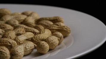 Cinematic, rotating shot of peanuts on a white surface - PEANUTS 013