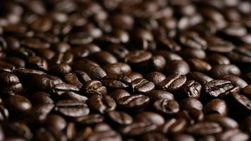 Rotating shot of delicious, roasted coffee beans on a white surface - COFFEE BEANS 023
