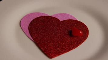 Rotating stock footage shot of Valentines decorations and candies - VALENTINES 0114