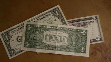 rotierender Schuss von amerikanischem Geld (Währung) - Geld 450