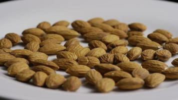 Cinematic, rotating shot of almonds on a white surface - ALMONDS 012