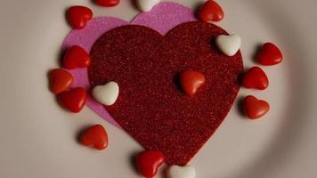 Rotating stock footage shot of Valentines decorations and candies - VALENTINES 0103