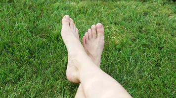 Woman's Feet On The Grass