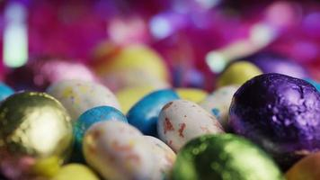 Rotating shot of colorful Easter candies on a bed of easter grass - EASTER 190 video