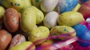 Rotating shot of colorful Easter candies on a bed of easter grass - EASTER 129 video