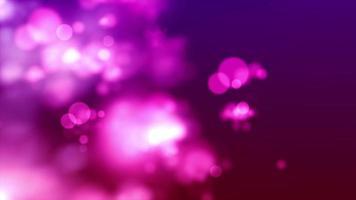 Las luces de bokeh rosa se desvanecen y se mueven sobre un fondo morado con viento
