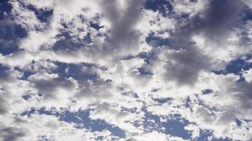 Time lapse of altocumulus clouds moving from right to left on blue sky in 4K video