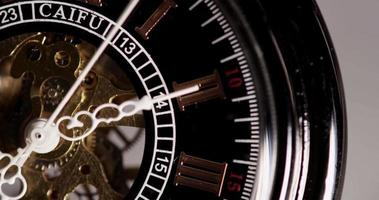 Extreme close up of pocket watch with exposed machinery coming from 7:09 to 7:40 in 4K time lapse video