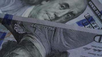 Rotating stock footage shot of $100 bills - MONEY 0140