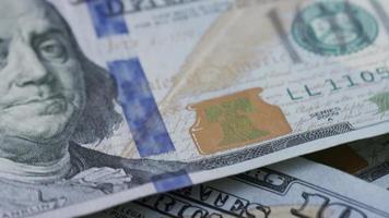 Rotating stock footage shot of $100 bills - MONEY 0137